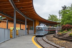 COURTESY PHOTO: KATHY STREET/THE OREGON ZOO - The Oregon Zoo's retro Zooliner pulls into a renovated, solar-powered train station on a recent test run. The zoo is offering free train rides Friday, May 27, as  the railway returns to action during the holiday weekend.