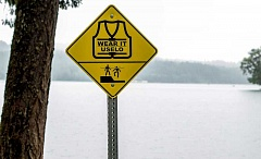 NEWS-TIMES PHOTO: TRAVIS LOOSE - Signs urging visitors to Hagg Lake to wear life jackets -- and warning them of a steep drop-off near the Sain Creek Picnic Area -- are posted at the popular venue near Gaston.