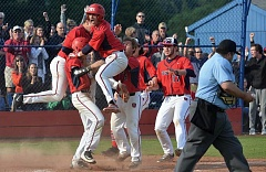 TIMES PHOTO: MATT SINGLEDECKER - Westview senior rightfielder Donovan Baldocchi and the Wildcat baseball team celebrate Rey Gonzalez's game-winning run against West Salem in the Class 6A quarterfinals on Friday.