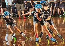 DAVID F. ASHTON - With arms swinging to build momentum, these racers from the Auburn Skate Club are trying their best at the Regional Competition race, held at the Oaks Park Roller Rink.