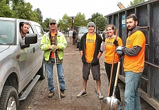 DAVID F. ASHTON - Scott McNeely standing with Bruce Heiberg and Tony Broga, along with Brenna Cahill and Billy Judge, were some of the volunteers helping with the 2016 SMILE Neighborhood Clean-Up in May.