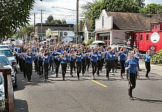 DAVID F. ASHTON - The SMS Marching Band plays, as the parade gets underway.