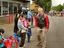 DAVID F. ASHTON - Eastmoreland resident, and Portlands Mayor, Charlie Hales greeted neighbors as he walked along the 82nd Avenue of Roses Parade route this year.