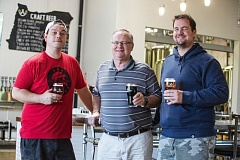 TIMES PHOTO: JONATHAN HOUSE - Ancestry Brewing owner Jerry Turner, center, with general manager and son Jeremy, right and PDX Sliders chef Ryan Rollins.