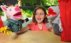 Mary Cekly enjoys the new puppet show in the childrens area.