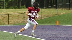 TIMES PHOTO: DAN BROOD - Tualatin junior Jared Ellison' a 6-foot-6 wide receiver' rolls in to score a touchdown after catching a pass from Crimson team quarterback Kaden Cook in the Timberwolves spring game on Saturday at Tualatin High School.