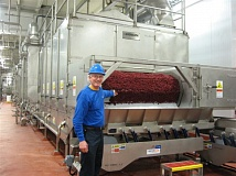 COURTESY NORPAC - Food manufacturers such as NORPAC are enjoying strong growth in Oregon right now.  Here, cranberries get squeezed.