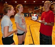 PAMPLIN MEDIA GROUP: JOHN DENNY - Chijo Takeda, the newvolleyball coach at La Salle Prep, gets acquainted with returning varsity players Sophie Griese (left) and Emmerson Smith during an open gym.