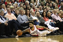 TRIBUNE FILE PHOTO: JAIME VALDEZ - Allen Crabbe of the Trail Blazers dives for a loose ball at Moda Center last season.