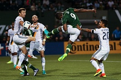 TRIBUNE PHOTO: DAVID BLAIR - Fanendo Adi of the Portland Timbers heads the ball toward the Los Angeles Galaxy goal.