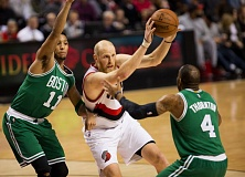 TRIBUNE FILE PHOTO: DAVID BLAIR - Evan Turner (left), defending Chris Kaman in a Portland-Boston game, reported has agreed to terms with the Trail Blazers as a free-agent guard-forward.