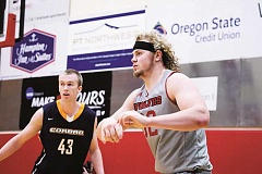 COURTESY PHOTO - Western Oregon senior forward Andy Avgi (right) was selected as an All-American by four different organizations, but also was a First Team All-Conference selection in the fall as a tight end for the Wolves football team.