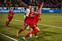 TRIBUNE PHOTO: DIEGO G. DIAZ - Defender Kat Williamson (5) scores for the Portland Thorns in the second half Saturday night at Providence Park and is congratulated by teammate Celeste Boureille.