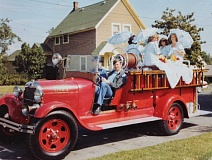 PHOTO COURTESY CHERYL SAVAGE LARSON - More than 35 years ago the West Linn Fair court readied for a parade in a vintage fire truck; princesses and parades have been a part of the annual event almost from the beginning.