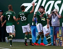 TRIBUNE PHOTO: JONATHAN HOUSE - The Portland Timbers celebrate a goal by Jack McInerney (right) on Wednesday night at Providence Park.