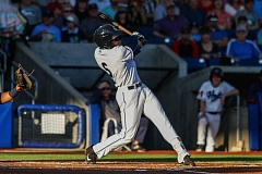 TRIBUNE PHOTO: CHASE ALLGOOD - Anfernee Grier of the Hillsboro Hops belts a two-run home run in the third inning Wednesday night at Ron Tonkin Field.