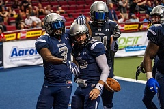 TRIBUNE PHOTO: DIEGO G. DIAZ - Portland Steel quarterback Shane Austin (10) gets congratulations from receivers Rashaad Carter (left) and Nick Truesdell after scoring a touchdown Saturday night against the Jacksonville Sharks. The Steel won 55-53 at Moda Center.
