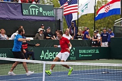 TRIBUNE PHOTO: JAIME VALDEZ - Borna Coric (right) celebrates after delivering the four-set victory, over Jack Sock, that gave Croatia a 3-2 win over the United States in the Davis Cup quarterfinals Sunday at Tualatin Hills Tennis Center.