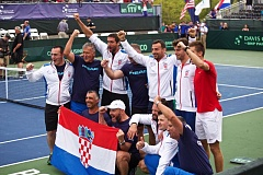 TRIBUNE PHOTO: JAIME VALDEZ - Croatia's team is jubilant after its two-day comeback to defeat the United States 3-2 in their Davis Cup quarterfinal tie at Tualatin Hills Tennis Center.