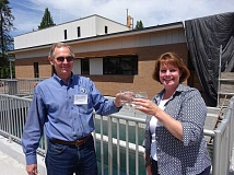 SUBMITTED PHOTO - Lake Oswego and Tigard city managers Scott Lazenby and Marty Wine celebrate the completion of the new system with glasses of drinking water.