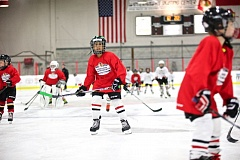 TIMES PHOTO: JAIME VALDEZ - Kids take part in drills during Winterhawks' Skate School program at Winterhawks Skating Center.
