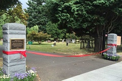 COURTESY PHOTO: METRO - New basalt columns grace the entrance to Portland's historic Lone Fir Cemetery.