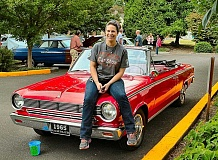 PHOTO BY DAVID F. ASHTON  - Sellwood Classic Car Show organizer Leah Tucker, of the City Slickers food cart on Tacoma Street, sits on her 1965 Rambler American 440 - one of four Ramblers her family owns, dating to 1963 through 1965.