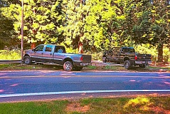 PHOTO COURTESY OF CAITLIN STAUFFER  - After a reported relationship breakdown, the driver of one truck rams another, near Reed College - on Sunday morning, June 26.