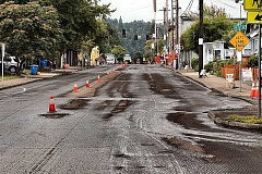 DAVID F. ASHTON - The Sellwood business district along S.E. Tacoma Street was closed off to traffic while the pavement surface was ground away.