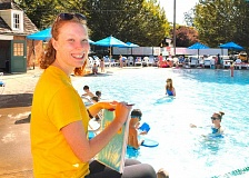 DAVID F. ASHTON - Portland Parks & Recreations Sellwood Pool Swim Team Coach Ann Jensen enjoys her mornings teaching kids how to swim, before she leaves for her summer internship at OHSU.