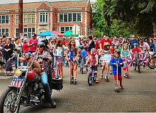 DAVID F. ASHTON - Following the parade precursor of classic cars, the marchers set out on the route of the 23rd annual Eastmoreland Fourth of July Neighborhood Parade.