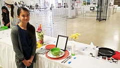 NEWS-TIMES PHOTOS: STEPHANIE HAUGEN - Gaston resident Siera Case is the youngest member of the Patton Valley Livestock club and won a blue ribbon in table setting at a judging before the Washington County Fair.
