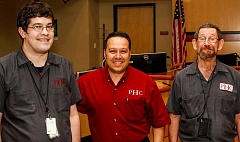 HILLSBORO TRIBUNE PHOTO: TRAVIS LOOSE - (Left to right) Portland Habilitation Center Northwests Edwin Lux, Abel Ovalle and Stephen Connor pause at the Hillsboro Civic Center.