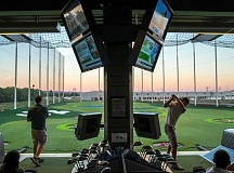 COURTESY: TOPGOLF - Players take turns on the driving range at TopGolf, which opens its 28th facility in Hillsboro on Friday.