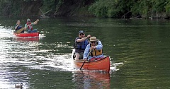 PAMPLIN MEDIA GROUP PHOTO: MILES VANCE - Forest Grove City Councilor Victoria Lowe (right) and Mark Jockers of Clean Water Services head to the finish line in Saturday's Political Paddle race on the Tualatin River, held each year by Tualatin Riverkeepers.
