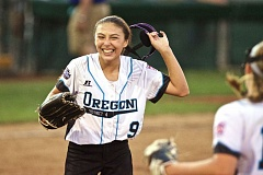 TRIBUNE PHOTO: JAIME VALDEZ - Lincoln/Southwest Portland pitcher Julia Jordan smiles after getting out of an inning Wednesday night against Latin America. The Oregon team won 8-4 in pool play at the Little League Softball World Series hosted by Alpenrose Dairy.