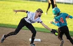 TRIBUNE PHOTO: JAIME VALDEZ - Jolie Maycumber, second baseman for the Lincoln/Southwest Portland Little League team, tags out Joanelis Santiago Perez of Latin America during Wednesday's Little League Softball World Series game at Alpenrose Stadium.