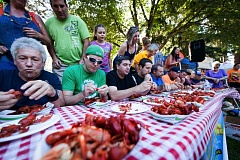 TIMES PHOTO: ADAM WICKHAM - Attendees at the 2016 Tualatin Crawfish Festival compete in the crawfish eating contest on Saturday at Tualatin Community Park.