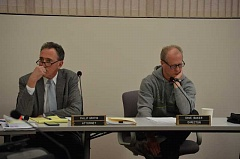 SPOTLIGHT FILE PHOTO - Philip Griffin, left, attorney for the Columbia River PUD, listens to public comments alongside PUD Director Dave Baker during a meeting March 15.