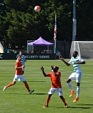TRIBUNE PHOTO: NATHANAEL MEADOWCROFT - Rennico Clarke (right) of Portland Timbers 2 goes for the ball at Merlo Field during Sunday's game against the Orange County Blues.