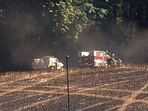 COURTESY PHOTO: TVF&R - Emergency vehicles tend to a fire near North Plains Sunday afternoon, Aug. 14, that burned 10 acres.