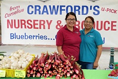 COURTESY PHOTO - Lene Zurita (left) and her mother Araceli Suano sell berries and vegetables at the Crawford's Produce booth each Wednesday at the Forest Grove Farmers Market.