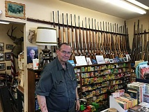 NEWS-TIMES PHOTO: RYAN LACKEY - Kurt Mueller, owner of H&K Gun Shop in Forest Grove, doesn't like either candidate for President.