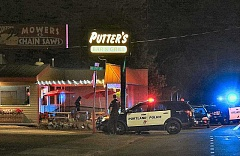 DAVID F. ASHTON - After running from the scene, the suspect ducked into Putters Bar and Grill - leaving a shoe behind when she ducked back out.