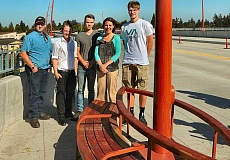DAVID F. ASHTON - Former students from the ACE Academy, who designed and constructed the benches that grace the new Sellwood Bridges belvederes, stand with Multnomah County Chair Deborah Kafoury.