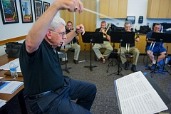 TIMES PHOTO: JOHN LARIVIERE - Conductor Jeff Williams leads a recent rehearsal of the Rose City Trombones as the group prepares for its upcoming trip to China.