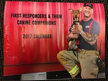 PHOTO COURTESY OF COLUMBIA RIVER FIRE AND RESCUE - The cover of a calendar for sale benefiting the Columbia Humane Society.