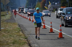 SPOTLIGHT PHOTO: NICOLE THILL - A Portland to Coast relay walker treks along Highway 30  just north of Havlik Drive in Scappoose. The 35th annual Hood to Coast and Portland to Coast relay was held on Friday, Aug. 26.