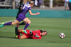 TRIBUNE PHOTO: JAIME VALDEZ - The University of Portland's Natalie Muth (left) has her kick blocked by Portland State goalkeeper Abbie Faingold in the first half Friday at Merlo Field.
