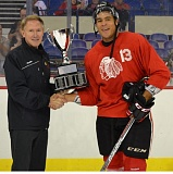 COURTESY: PORTLAND WINTERHAWKS - Keegan Iverson (right) accepts the Neely Cup trophy Sunday at Memorial Coliseum from Portland Winterhawks coach/general manager Mike Johnston.